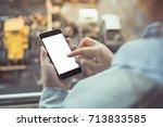 business woman holding phone...   Shutterstock . vector #713833585