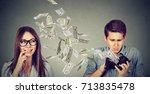 sad man looking at his wallet... | Shutterstock . vector #713835478