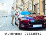 nice good looking man holding... | Shutterstock . vector #713835562