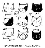 hand drawn cat faces set with... | Shutterstock .eps vector #713856448