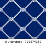 seamless rope net with knots... | Shutterstock .eps vector #713874352