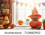 carving pumpkin on the table at ... | Shutterstock . vector #713882902