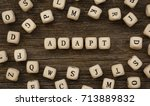 Small photo of Word ADAPT written on wood block