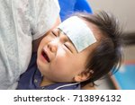 mother is holding a sick little ... | Shutterstock . vector #713896132