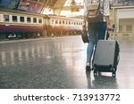 at train station young tourist... | Shutterstock . vector #713913772