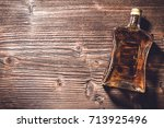 bottle of whiskey on wooden... | Shutterstock . vector #713925496
