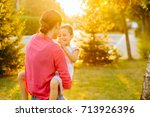 beautiful young mother and her... | Shutterstock . vector #713926396