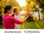 beautiful young mother and her...   Shutterstock . vector #713926426