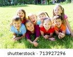 kids outside in park | Shutterstock . vector #713927296