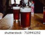 Small photo of An english ale bitter beer pint on a wooden table in a pub in UK