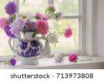 Asters In Teapot On Windowsill