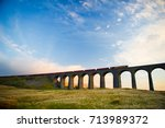 train crosses the famous... | Shutterstock . vector #713989372