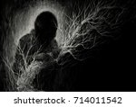 the man and the tree. black and ... | Shutterstock . vector #714011542