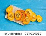 sliced pumpkin on kitchen desk | Shutterstock . vector #714014092