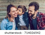Small photo of Happy family is having fun outdoors. Father, mother and son are spending time together.