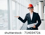 man architect in protective... | Shutterstock . vector #714034726