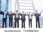 happy successful business group ... | Shutterstock . vector #714086362