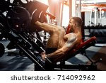 man using a press machine in a... | Shutterstock . vector #714092962