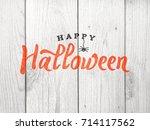 happy halloween typography over ... | Shutterstock . vector #714117562