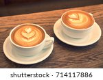 a cup of hot latte art coffee... | Shutterstock . vector #714117886