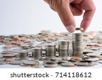male hand putting coins with...   Shutterstock . vector #714118612