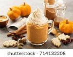 pumpkin spice latte in a glass... | Shutterstock . vector #714132208