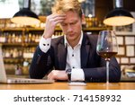 businessman hangover suffering... | Shutterstock . vector #714158932