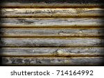 Small photo of Dark brown and black shaded wooden walls with dark rich shading and texture. Wood grain with textured flat surface.