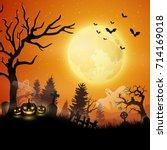 halloween night with pumpkins... | Shutterstock . vector #714169018