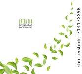 flying green leaves on white... | Shutterstock .eps vector #714173398