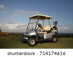 a golf cart parked at a tee box ...   Shutterstock . vector #714174616