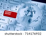Small photo of Expert advice and support service concept : Two words EXPERT ADVICE inscribed on a red enter key button of a white desktop computer keyboard decorated with a crystal clear globe and opaque world map.