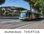 A modern electric streetcar passing through Rome near the Colosseum - stock photo