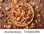 assorted nuts | Shutterstock . vector #714203398