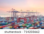 container terminal in sunset  ... | Shutterstock . vector #714203662