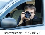 a man is taking photo someone... | Shutterstock . vector #714210178