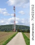 Telecommunication Towers On An...