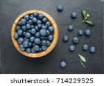 fresh blueberries with leaves ... | Shutterstock . vector #714229525