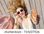 woman in swimsuit showing a... | Shutterstock . vector #714237526