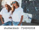 two models wearing plain white... | Shutterstock . vector #714241018