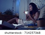 pretty woman eating ramen soup... | Shutterstock . vector #714257368