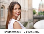 Stock photo young woman sightseeing in the old town of hannover germany with new city hall landmark building 714268282