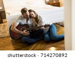 happy couple sitting on the... | Shutterstock . vector #714270892