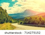 driving a car on mountain road. ... | Shutterstock . vector #714275152
