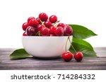 fresh red cherry fruit in plate ... | Shutterstock . vector #714284332