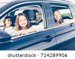 young woman is driving a car... | Shutterstock . vector #714289906