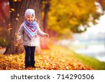 adorable happy girl playing... | Shutterstock . vector #714290506