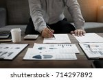 business man analysed report of ... | Shutterstock . vector #714297892