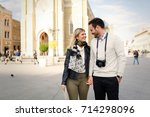 couple enjoying sightseeing and ... | Shutterstock . vector #714298096
