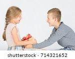 boy giving a present to a girl  ... | Shutterstock . vector #714321652